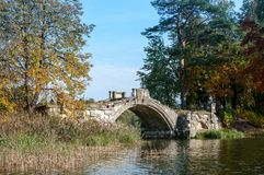Old stone hump-back bridge in Gatchina.  Russia Royalty Free Stock Photos