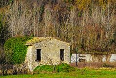 Old stone hut in winter rural landscape royalty free stock images