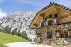 Old stone hut with mountain Gartnerkofel in Carnic Alps stock photography