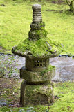 Old Stone Lantern at Japanese Garden. Old Stone Lantern covered in green moss at Japanese Garden Stock Photo