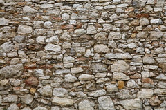 Old stone layered wall of fortress or castle Stock Photography