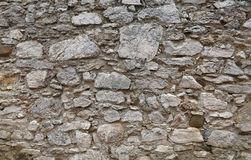 Old stone layered wall of fortress or castle Royalty Free Stock Photography
