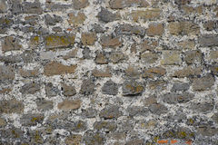 Old stone layered wall Royalty Free Stock Images