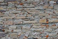 Old stone layered wall Royalty Free Stock Photo