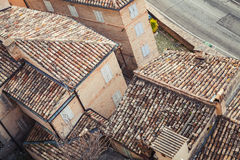 Old stone living houses along empty street, Italy Royalty Free Stock Images
