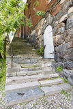 Old stone stair and a white door. Old stone made stair and a white door in old earth stone building Royalty Free Stock Images