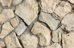 Old stone masonry with cement mortar texture background Stock Image