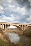Old stone middle age bridge in Bulgaria,  cloudy sky Stock Image