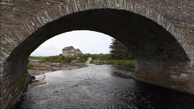 An Old stone mill and bridge in Thurso, Scotland stock video footage