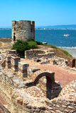 The old stone mill. Nessebar. Bulgaria. The ruins of the old stone mill and the ruins of a Byzantine basilica of the VI century. Nessebar. Bulgaria Stock Photo