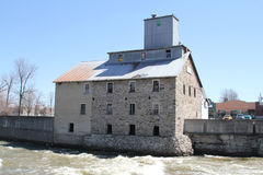 Old stone mill on the river Stock Photo