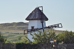 Old stone mill with a thatched roof Stock Photos
