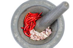 Old stone Mortar and Pestle with red chill and Garlici Stock Photos
