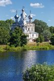 Old stone Orthodox Church on banks of the river in Russia. Stock Images