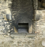 Old stone oven. Old sooty stone oven detail Royalty Free Stock Image