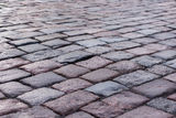Old stone paved avenue street road Royalty Free Stock Photos