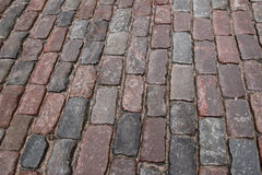 Old stone paved avenue street road, low angle Royalty Free Stock Photo