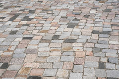 Old stone pavement - mixed cobblestone background. Street floor royalty free stock images