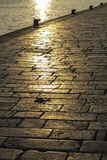 Old stone pavement texture at sunset Stock Image
