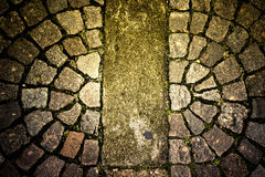 Old stone paving stones on the road Stock Photo