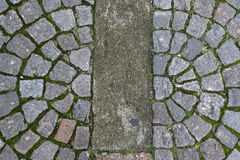 Old stone paving stones on the road Royalty Free Stock Photography