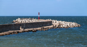 Old stone pier with a lighthouse Royalty Free Stock Photography