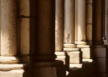 Old Stone Pillars. With the sun shining through them on a bright day stock images