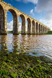 Old stone railway bridge and seaweed royalty free stock images