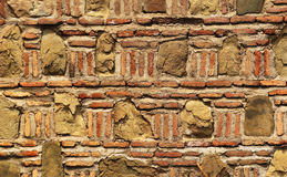 Old stone red brick wall mosaic background.  Stock Images