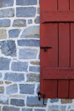 Old stone and red shutters Stock Images