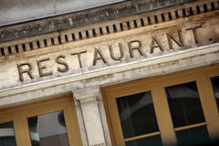 Old stone restaurant sign and front entrance, Paris, France Stock Photo