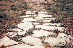 Old stone road, close up stone slab stock photo