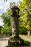 Old stone road column Stock Photo