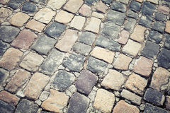 Old stone road pavement, background texture Stock Photography