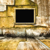 The old stone room with wooden picture frame Royalty Free Stock Images