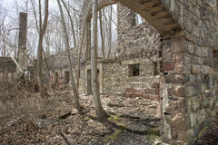 Old Stone Ruin in a Forest. Granite stone remains of an ruined barn in a New York forest Stock Photography