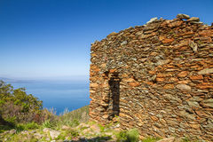 Old stone ruin overlooking mediterranean Stock Images
