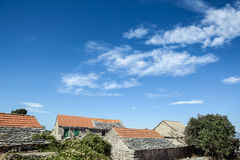 Old stone rustic house and blue sky Royalty Free Stock Photography