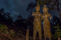 Old stone sculpture in Thailand. Stock Photos