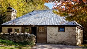 Old Stone Settlers Cottage In Arrowtown New Zealand. An old stone settlers cottage from a bygone era, Arrowtown New Zealand during autumn Stock Image
