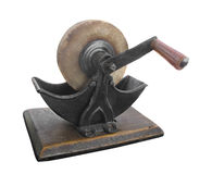 Old stone sharpening grinding wheel isolated. Stock Image