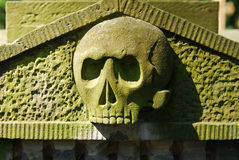 Old stone skull from graveyard stock image