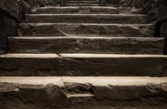 Old stone staircase. Ancient temple interior. Ancient stone stairs. Historic site concept photo. For wallpaper or background. Rough staircase in Angkor Wat Royalty Free Stock Photos