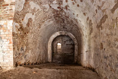 Old stone staircase leads to the dungeon.  Fort Tarakanovskiy. U Royalty Free Stock Photo