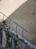 Old stone staircase. With metal railing stock image