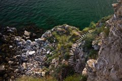 Old stone stairs. Some old stairs leading to the sea stock photos