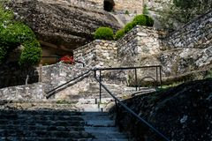Old stone stairs and beatiful garden in ancient monastery in Greece. No people at old stone stairs and beatiful garden in ancient monastery in Greece royalty free stock images