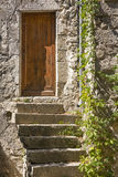Old stone stairs with entrance door Royalty Free Stock Photo