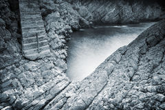 Old stone stairs goes to the sea backwater Royalty Free Stock Image