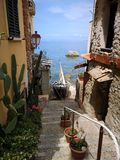 Old stairs going down to the sea in Scilla royalty free stock photos